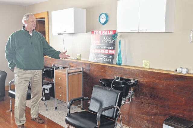 Greg Stolly, a real estate agent at Real Living CCR Realtors, shows his property for sale at 1040 Shawnee Road. This is one of the many commerical properties that new business owners can purchase.