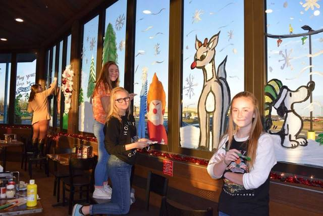 Elida High School students in Mrs. Erin Johnson's art class spent several days bringing holiday cheer to the windows of Mellow Mushroom. Submitted