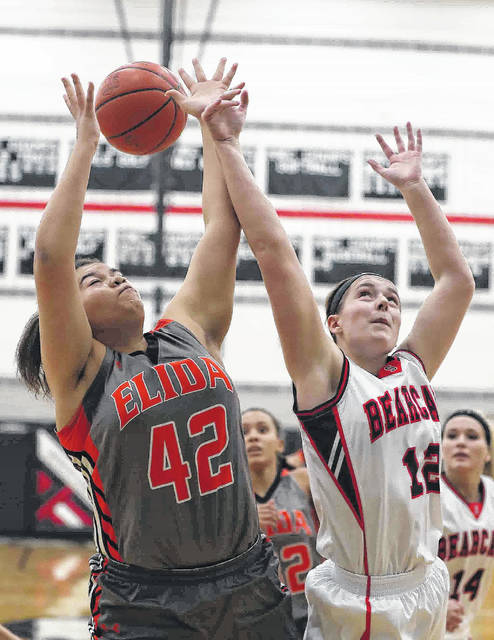 Elida's Alissa Cuffy and Spencerville's Olivia Clark fight for a rebound during Tuesday night's game at Spencerville High School.