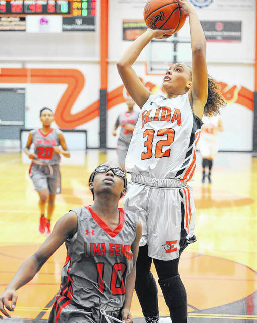 Elida's Amiah Jones shoots against Lima Senior's Nakiya Sigman during Thursday's Vicki Mauk Holiday Classic at the Elida Fieldhouse. Jones had eight points for Elida.