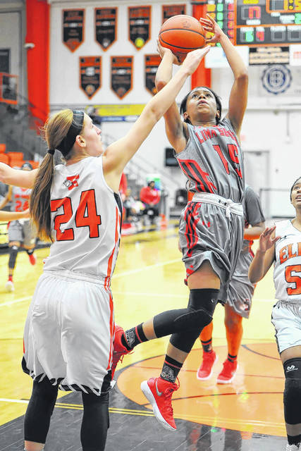 Lima Senior's Destiny McDonald shoots against Elida's Shyah Wheeler during Thursday's Vicki Mauk Holiday Classic at the Elida Fieldhouse. McDonald had 11 points and seven rebounds.