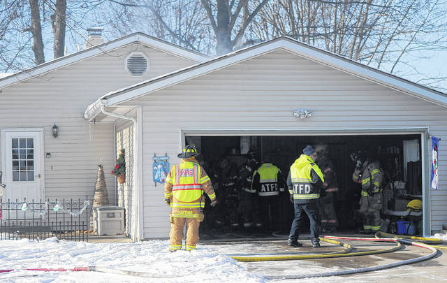 Firefighters with American Township Fire Department help with a house fire at 2785 Hummingbird St., Lima.