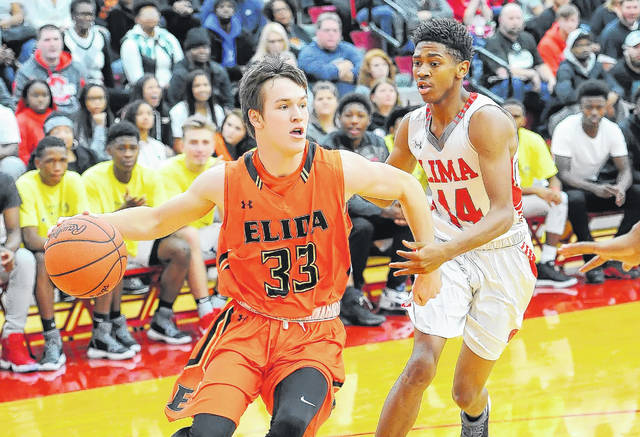 Elida's Daniel Unruh drives against Lima Senior's Jermaine Daniel during Saturday night's game at Lima Senior. Find game summaries, photo galleries and more at LimaScores.com.