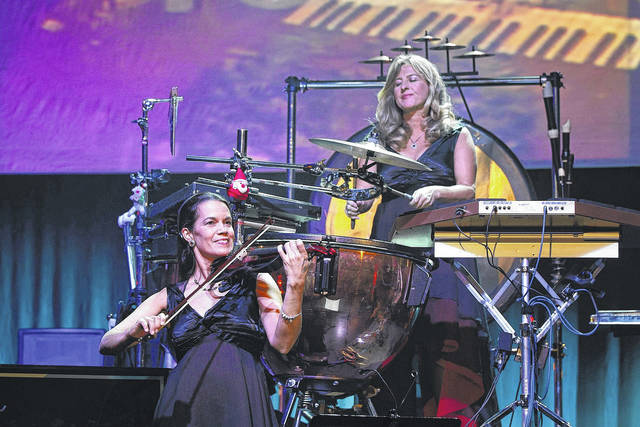 Musicians Roxanne Layton and Becky Kia perform with Mannheim Steamroller.