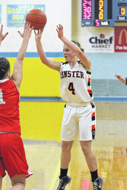 Minster's Ivy Wolf puts up a shot during Saturday night's McDonald's Holiday Tournament championship game at Bath. See more tourney photos at LimaScores.com.