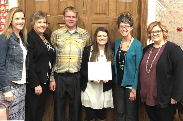 Gabi Dershem, a student at Miller City High School, was honored recently by the Putnam County Optimist Club.