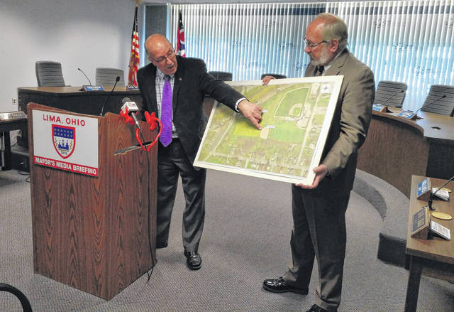 Lima Utilities Director Michael Caprella, left, along with Mayor David Berger, offers more details on the construction of a 13-million gallon combined sewer overflow tank to be placed near Simmons Field. The $40 million project is slated to begin in the spring.