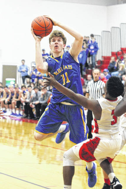 Perry's Nylan Cannon draws the charge as Richard Cocuzza of Delphos St. John's goes for a shot during Saturday night's game at Perry.