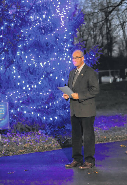 Richard Kohli, chairman of criminal justice of Rhodes State College, speaks during the Third Annual Memorial Tree Lighting to Honor Fallen Criminal Justice Officers and K-9 officers who lost their lives in the line of duty during 2017 in the United States.