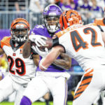 Vikings cruise past Bengals 34-7 to clinch NFC North