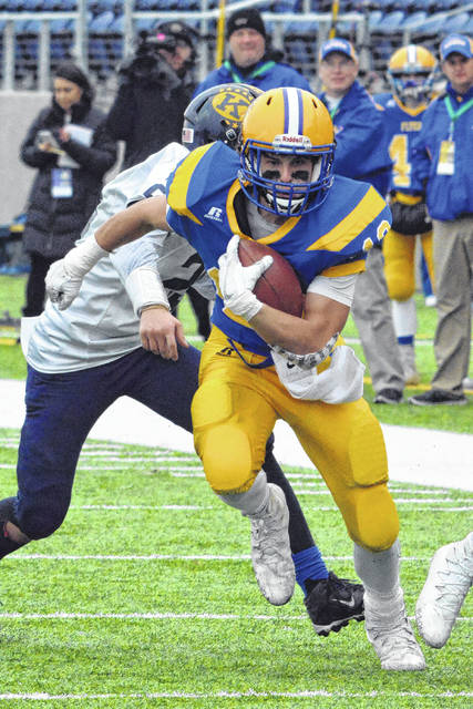 Marion Local's Nolan Habodasz finds running room during Saturday's Division VI championship game against Kirtland at Tom Benson Hall of Fame Stadium.