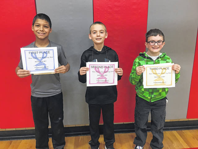 From left, James Albers won the New Knoxville Spelling Bee, ahead of second-place finished Jay Schroeder and third-place finished William Jones.