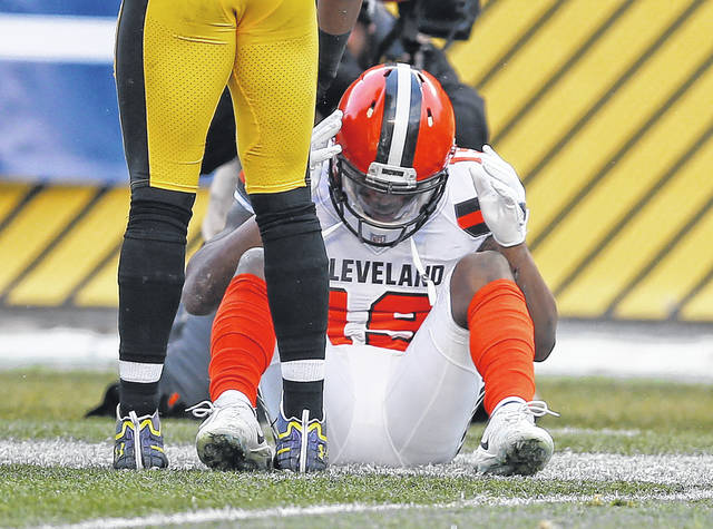Cleveland wide receiver Corey Coleman (19) sits on the field after not catching a pass from DeShone Kizer late in Sunday's game against the Steelers in Pittsburgh.