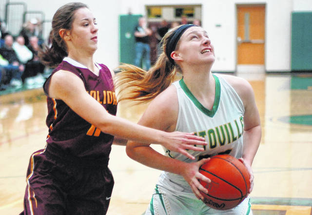 Ottoville's Haley Hoersten looks to put up a shot against Kalida's McKayla Maag during Friday night's game in Ottoville.