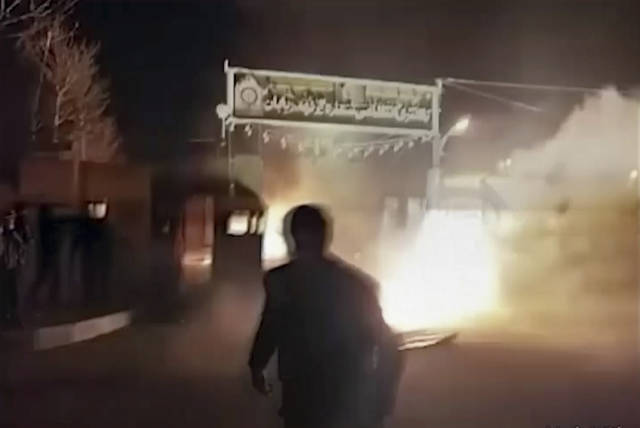 """This frame grab from video was taken by an individual not employed by the Associated Press and obtained by the AP outside Iran from FreedomMessenger, that describes itself as an """"independent Iranian news agency seeking complete change of the Iranian regime by reporting on the human rights situation in Iran,"""" purports to show attack on Iran police station in Qahdarijan, Iran, Tuesday, Jan. 2, 2018. Six rioters were killed during the attack on the police station, according to Iranian state TV. It reported that clashes were sparked by rioters who tried to steal guns from the police station. (FreedomMessenger via AP)"""