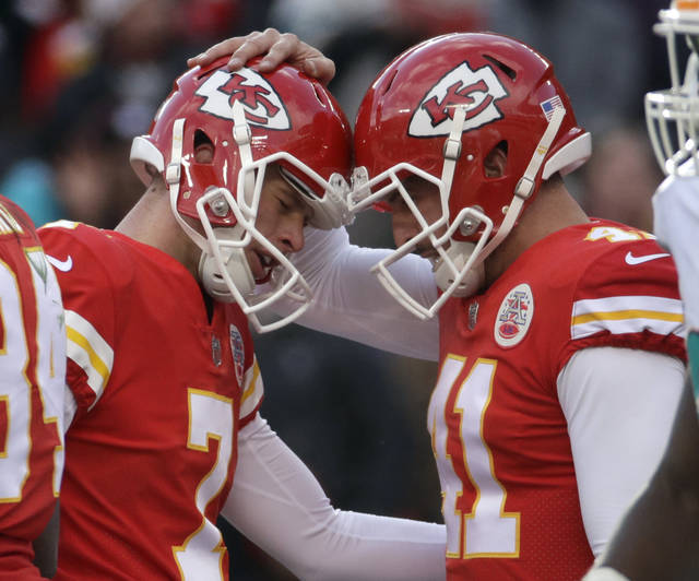 Kansas City Chiefs kicker Harrison Butker (7) is congratulated by quarterback Alex Smith (11) after he scored a field goal during the first half of an NFL football game against the Miami Dolphins in Kansas City, Mo., Sunday, Dec. 24, 2017. (AP Photo/Charlie Riedel)