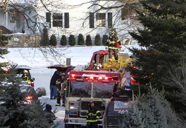 FILE - In this Wednesday, Jan. 3, 2018 file photo, firefighters work at the scene of a small fire on a property at the home of former President Bill Clinton and his wife Hillary Clinton in Chappaqua, N.Y. A Clinton spokesman tweeted that the fire was in a building used by the Secret Service, not in the Clintons' residence. On Friday, Jan. 5, 2018, The Associated Press reported that stories circulating on the internet about a room full of servers and hard drives destroyed in the fire are untrue. (Frank Becerra Jr./The Journal News via AP)