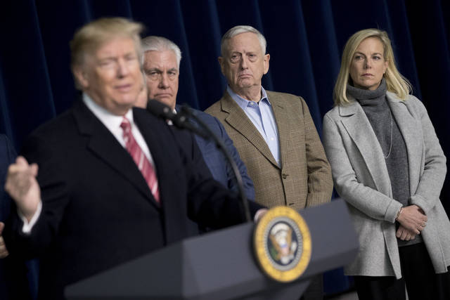 From left, President Donald Trump, accompanied by Secretary of State Rex Tillerson, Defense Secretary Jim Mattis, and Secretary of Homeland Security Kirstjen Nielsen, speaks to members of the media after participating in a Congressional Republican Leadership Retreat at Camp David, Md., Saturday, Jan. 6, 2018. (AP Photo/Andrew Harnik)