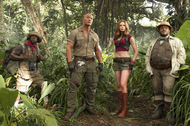 """FILE - This file image released by Sony Pictures shows Kevin Hart, from left, Dwayne Johnson, Karen Gillan and Jack Black in """"Jumanji: Welcome to the Jungle."""" Columbia Pictures says Sunday, Jan. 7, 2018, that the Johnson-led """"Jumanji"""" is estimated to have earned an additional $36 million, bringing its total to $244.4 million. (Frank Masi/Sony Pictures via AP, File)"""