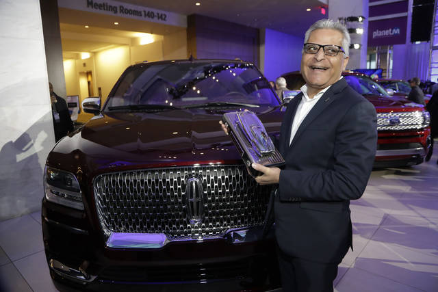 CORRECTS VEHICLE BRAND TO LINCOLN NAVIGATOR, INSTEAD OF FORD NAVIGATOR - Kumar Galhotra group vice president for Lincoln, stands next to the 2018 Lincoln Navigator after the vehicle won truck of the year during the North American International Auto Show, Monday, Jan. 15, 2018, in Detroit. (AP Photo/Carlos Osorio)