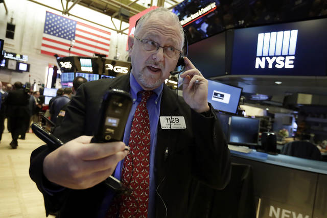 Trader Robert Moran works on the floor of the New York Stock Exchange, Wednesday, Jan. 17, 2018. Stocks are opening higher on Wall Street as the market makes up some of the ground it lost a day earlier. (AP Photo/Richard Drew)