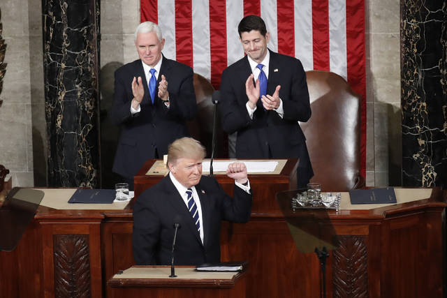 In this Feb. 28, 2017, photo, President Donald Trump, flanked by Vice President Mike Pence and House Speaker Paul Ryan of Wis., gestures on Capitol Hill, before his address to a joint session of Congress. (AP Photo/Pablo Martinez Monsivais)