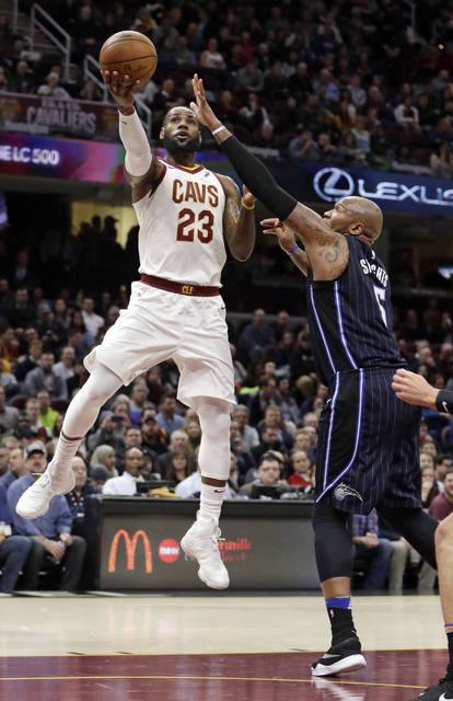 Cleveland Cavaliers' LeBron James shoots over Orlando Magic's Marreese Speights during the first half of an NBA basketball game Thursday, Jan. 18, 2018, in Cleveland. (AP Photo/Tony Dejak)