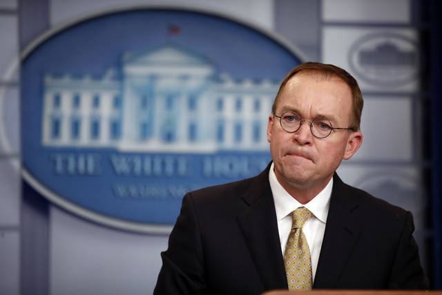 Director of the Office of Management and Budget Mick Mulvaney listens to a question during a press briefing at the White House, Saturday, Jan. 20, 2018, in Washington. (AP Photo/Alex Brandon)