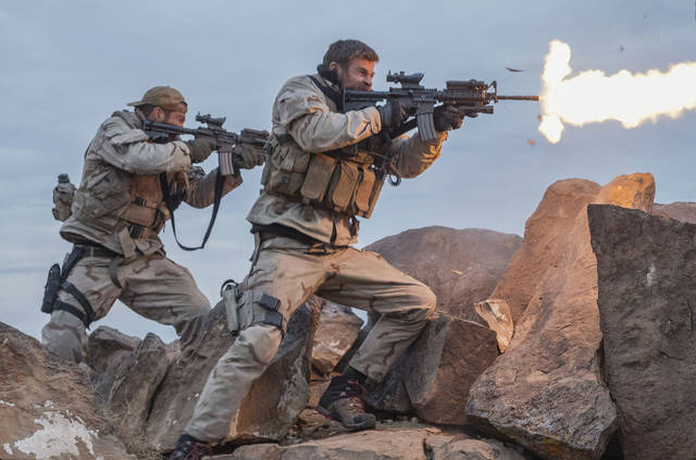 "FILE - This file image released by Warner Bros. Entertainment shows Geoff Stults, left, and Chris Hemsworth in a scene from ""12 Strong."" ""Jumanji"" sold $20 million in tickets, according to studio estimates Sunday, Jan. 21, 2018, bringing its five-week domestic total to $317 million. Landing in second is Warner Bros.' war drama ""12 Strong,"" starring Hemsworth. It grossed $16.5 million in its debut weekend. (David James/Warner Bros. Entertainment via AP, File)"