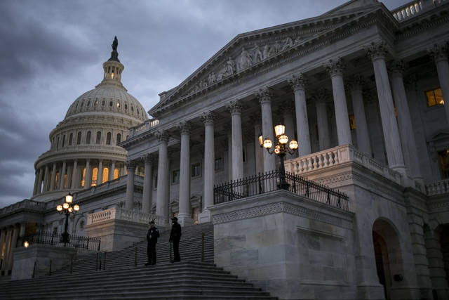 Night falls on the U.S. Capitol on second day of the federal shutdown as lawmakers negotiate behind closed doors in Washington, Sunday, Jan. 21, 2018. (AP Photo/J. Scott Applewhite)