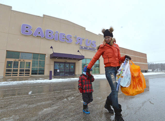 Jennifer Merva and her son Sebastian Merva, 4, leave Babies R Us in Summit Township, Pa., on Wednesday, Jan. 24, 2018, after shopping for gifts for a baby shower. As part of a Chapter 11 bankruptcy reorganization, parent company Toys R Us announced on Jan. 24 that the Summit Township store would be one of 182 stores to close over the next few months. (Christopher Millette/Erie Times-News via AP)