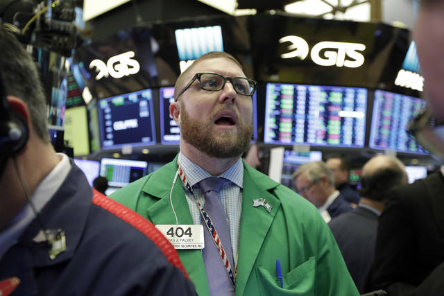 Trader Ryan Falvey works on the floor of the New York Stock Exchange, Wednesday, Jan. 24, 2018. Health care and consumer-focused companies are rising in early trading as stocks look to extend their winning streak to a fourth day. (AP Photo/Richard Drew)