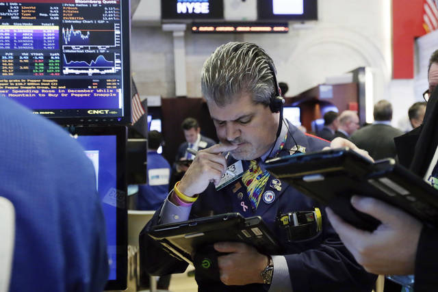 Trader John Panin works on the floor of the New York Stock Exchange, Monday, Jan. 29, 2018. The major U.S. stock indexes are down slightly in early trading Monday, as losses in technology companies outweighed gains elsewhere. (AP Photo/Richard Drew)