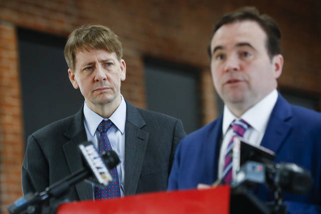 Cincinnati Mayor John Cranley, right, endorses Gubernatorial candidate Richard Cordray, left, during a news conference, Tuesday, Jan. 30, 2018, in Cincinnati. Cranley says local governments have been hurt by Republican control of Ohio's Statehouse and that Cordray will work with cities.  (AP Photo/John Minchillo)