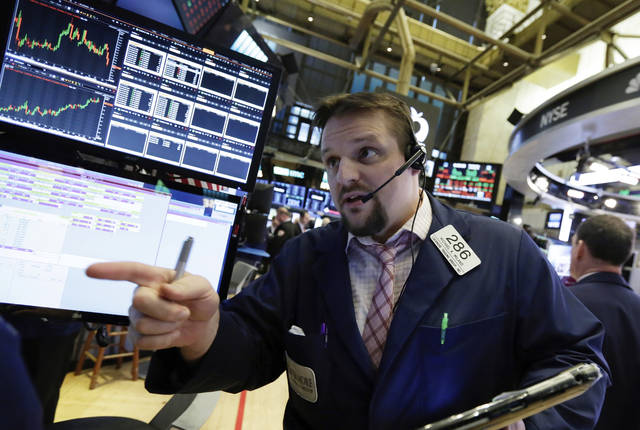 Trader Michael Milano works on the floor of the New York Stock Exchange, Wednesday, Jan. 31, 2018. Stocks are opening solidly higher on Wall Street after a number of big U.S. companies reported strong quarterly earnings. (AP Photo/Richard Drew)