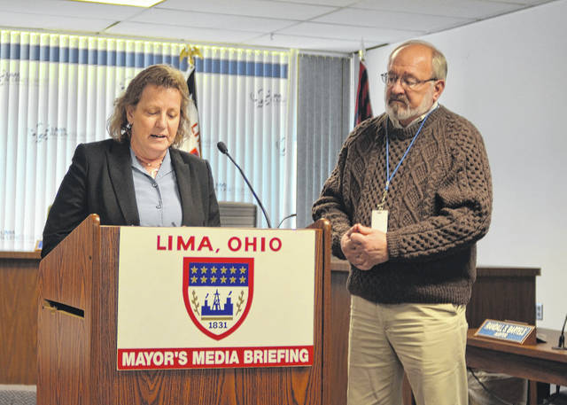 Amy Harpster, the newly appointed Building Official for the City of Lima Allen Couny Building Department, expresses her gratitude towards the Mayor and city council during Lima Mayor Berger's press conference, Wednesday.