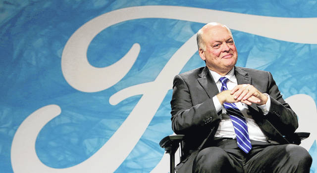 Ford Motor Company President and CEO Jim Hackett speaks in May at the Ford Motor Company World Headquarters in Dearborn, Mich. Ford said Thursday third quarter profits were $1.6 billion, a 63 percent increase from a year ago, but investors are still curious and sometimes confused about the futuristic language the company's leader uses.
