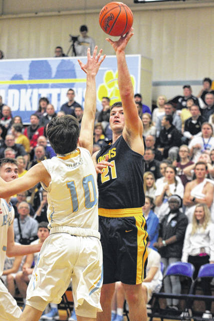 Ottawa Glandorf's Jake Dible puts up a shot against Bath's Dylan Mohr during Friday night's game at Bath.