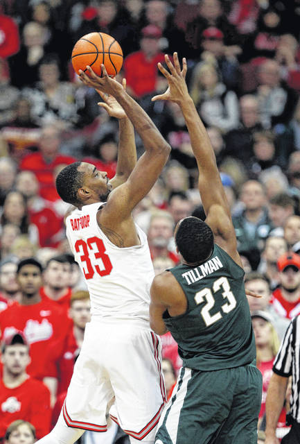 Ohio State forward Keita Bates-Diop, left, goes up to shoot against Michigan State forward Xavier Tillman during the first half of an NCAA college basketball game in Columbus, Ohio, Sunday, Jan. 7, 2018. (AP Photo/Paul Vernon)