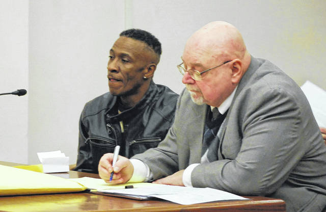 Calvin Goode answers questions in court Monday during his sentencing hearing on charges of robbery and dealing in marijuana. He is pictured with attorney Greg Donohue.