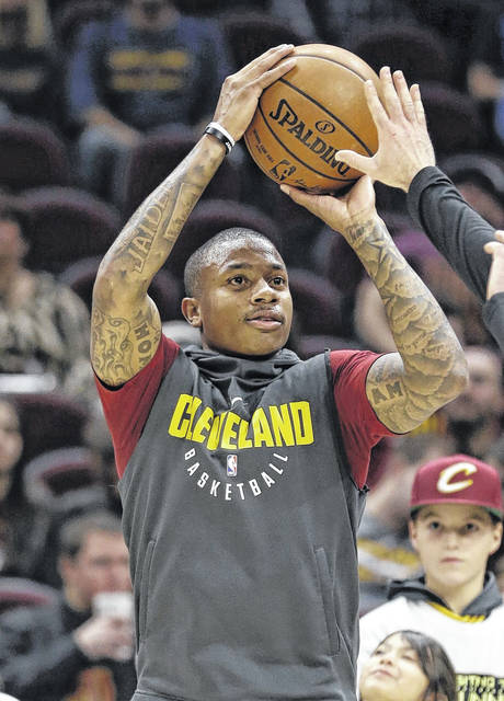 File- This Nov. 22, 2017, file photo shows Cleveland Cavaliers' Isaiah Thomas warming up for the team's NBA basketball game against the Brooklyn Nets in Cleveland.  Thomas will make his debut for Cleveland on Tuesday night against Portland after being sidelined with a hip injury. The All-Star has been out since last year's Eastern Conference finals with Boston. But after months of grueling rehab, Thomas will finally take the floor with Cleveland, which acquired him during the offseason in the blockbuster trade that sent Kyrie Irving to the Celtics. Thomas has building up his strength in recent weeks in scrimmages and has finally been cleared by Cleveland's medical and training staffs to play in a game. (AP Photo/Tony Dejak, File)