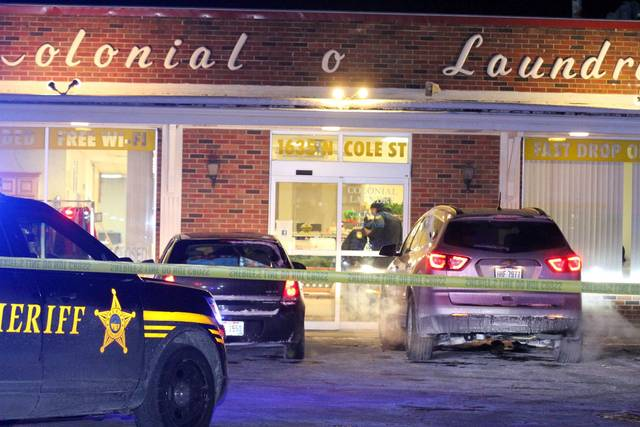 Allen County Sheriff's respond to a shooting at Colonial O' Laundry, at 1635 N Cole Street late Tuesday night.   Levi A. Morman | The Lima News
