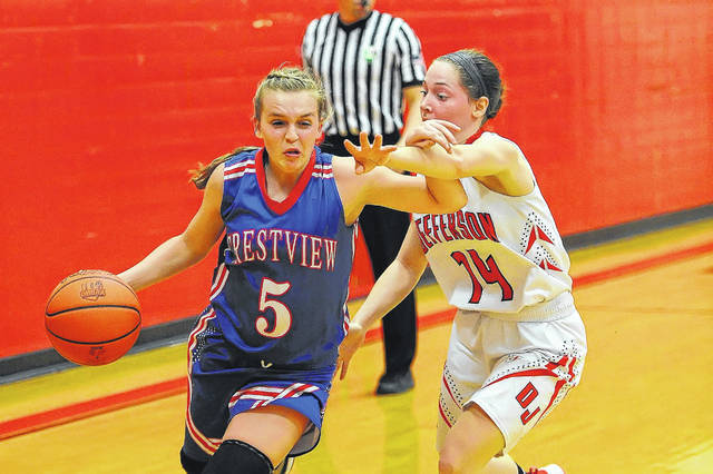 Crestview's Lexi Gregory drives against Jefferson's Devyn Carder during Thursday night's game in Delphos. See more game photos at LimaScores.com.