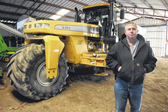 Jan Layman, of Kenton, stands next to a high-tech Terra Gator 6303 fertilizer and lime spreader. An estimated cost of a 2018 Terra Gator is $350,000. Layman says it's a worthwhile investment to use as little fertilizer as needed while following Ohio's updated fertilizer application rules.