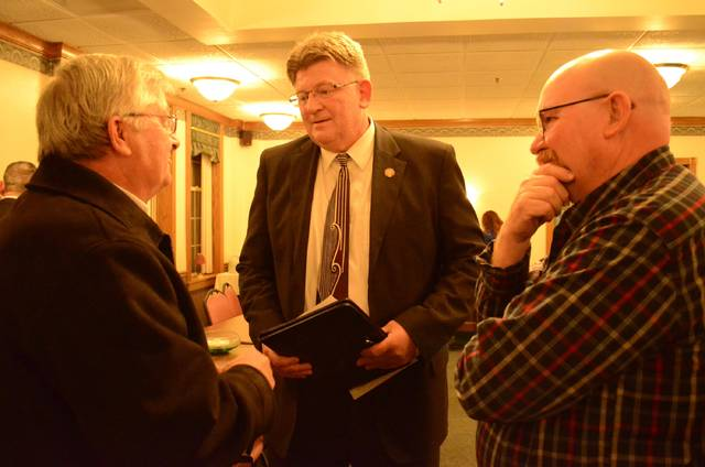 New State Rep. Jim Hoops speaks with Denny Schroeder, of Leipsic (left), and Pandora Mayor John Schlumbohm (right), during the Putnam County Republican Party meeting Wednesday. Hoops was sworn in Wednesday.