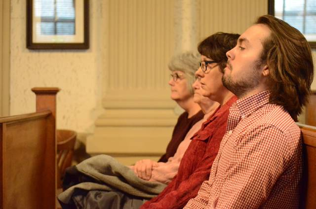 Michael Luebrecht's son, Lucas, and Luebrecht's wife, Amy, look on as the jury announced a guilty verdict Friday. After already serving 12 years for aggravated murder, Luebrecht will be sentenced again at 2 p.m. at the Putnam County Court of Common Pleas.