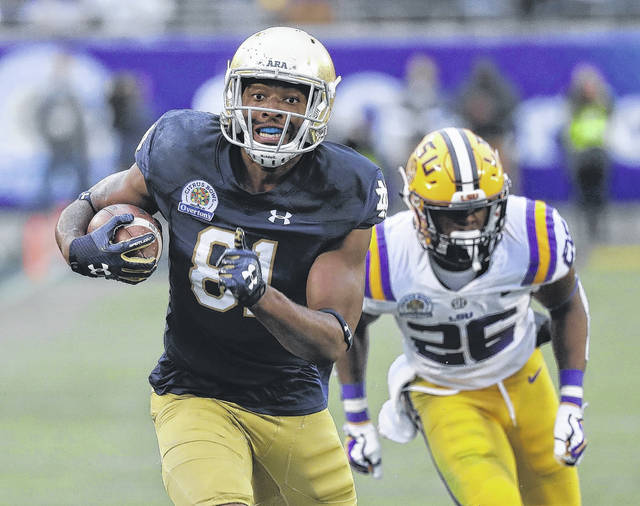 Notre Dame wide receiver Miles Boykin, left, runs to the end zone past LSU safety John Battle (26) on his way to the score the game-winning touchdown during the second half of the Citrus Bowl on Monday.