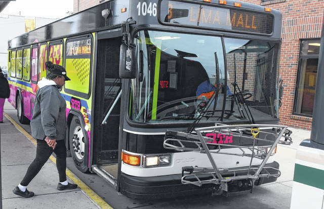 A passenger enters an RTA bus to the Lima Mall at the station in downtown Lima. Craig J. Orosz   The Lima News