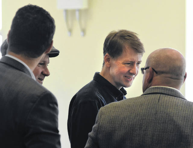 In this 2017 file photo, Democrat for Governor Richard Cordray, talks with members of the Lima Building and Construction Trades Council at it annual holiday luncheon on Friday at Lima City Club.