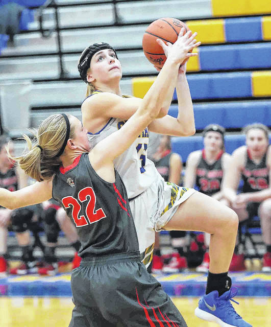 St. Marys' Lauren Cisco puts up a shot against Van Wert's Cassidy Meyers during Thursday night's game at St. Marys.